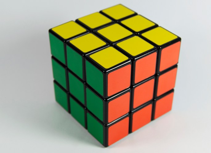 Yellow, Orange, and Green 3x3 Rubik's Cube