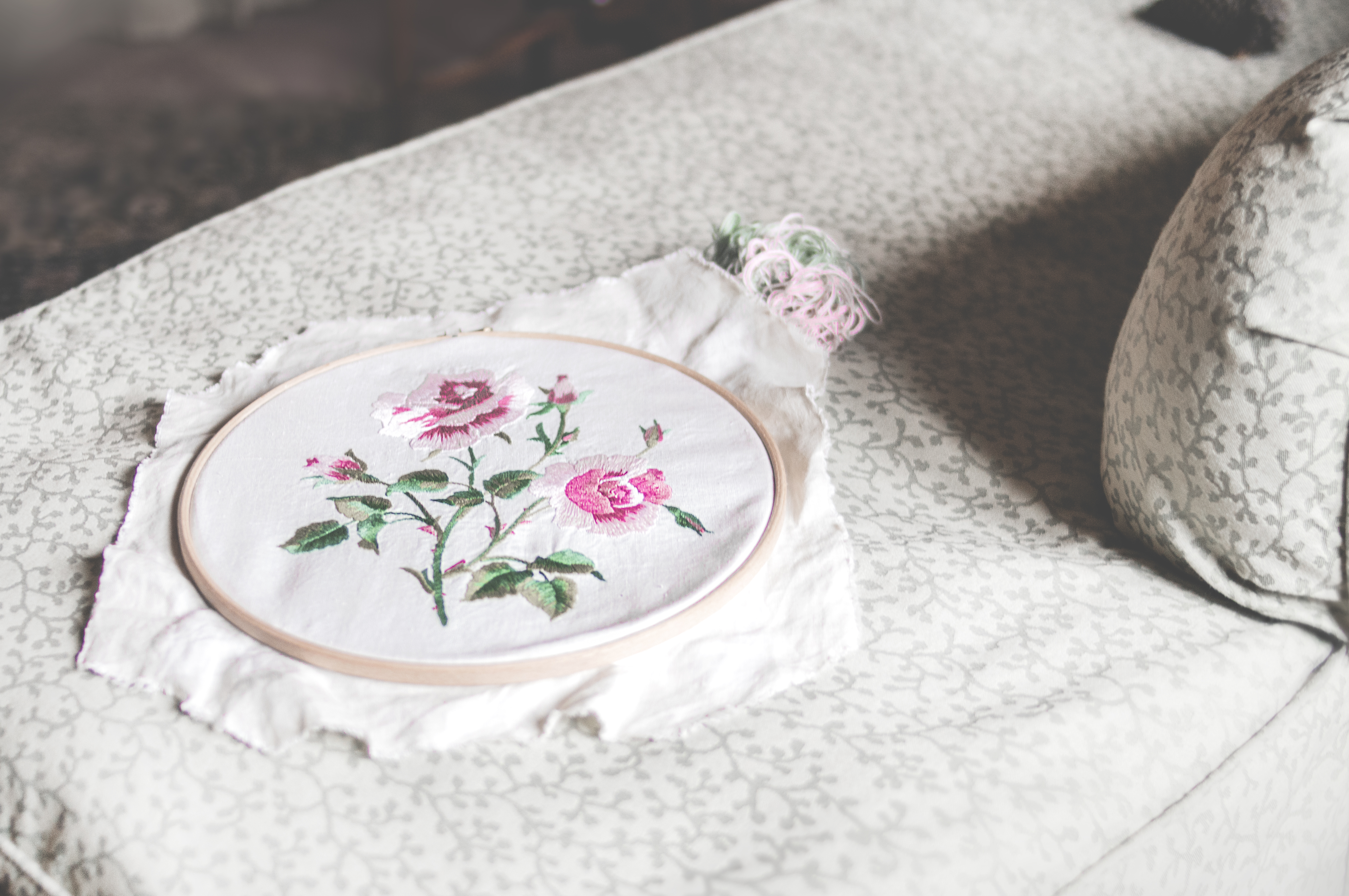 Roses embroidered on white fabric