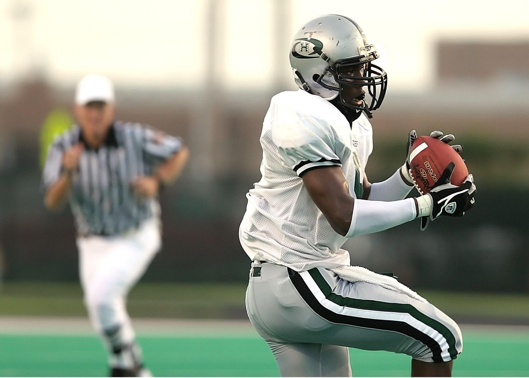 player holding football ball