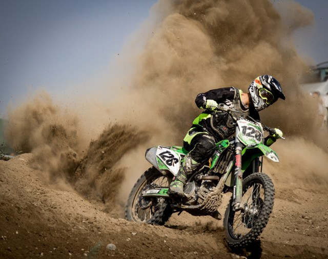 Rider Riding Green Motocross Dirt Bike