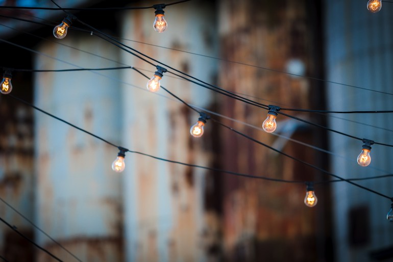 Close-up of Illuminated Lighting Equipment Against the Sky