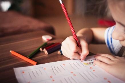 Close-up of Girl Writing