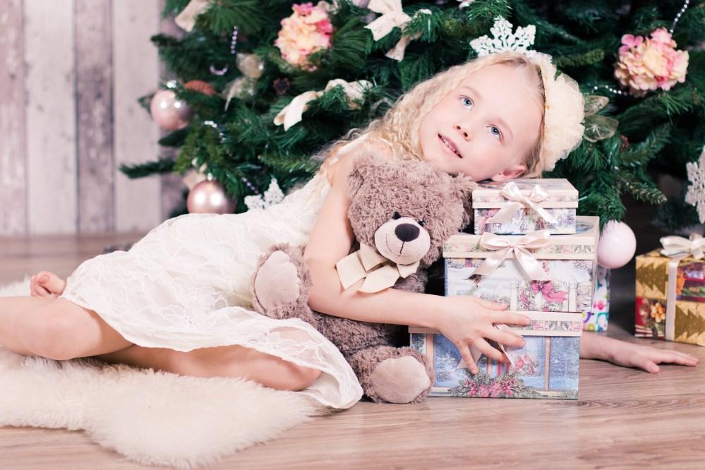 Girl Lying Beside Three Gift Boxes