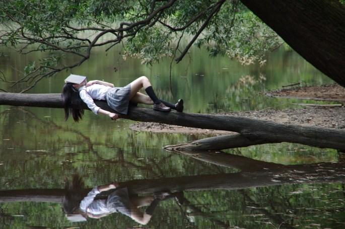Woman Lying on Tree Near Awter