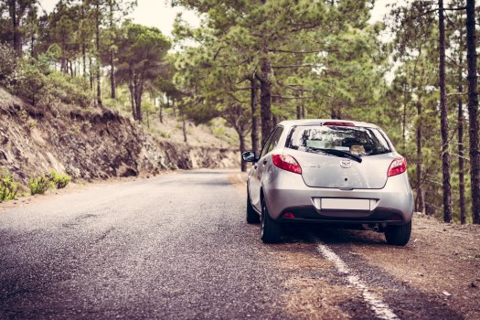 Selective Focus Photography of Nissan Vehicle on Road