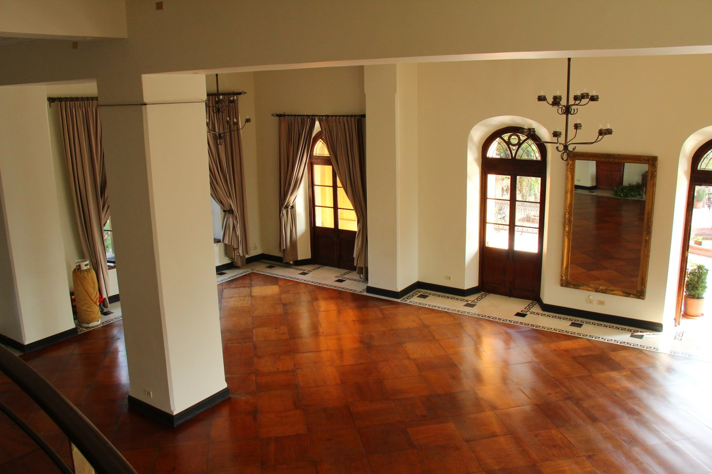 photograph of a hallway with wooden floors and doors