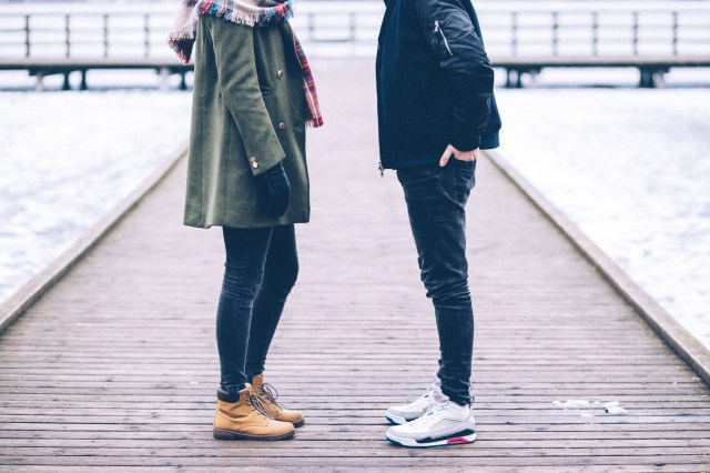 Woman and Man Standing on Brown Wooden Dock