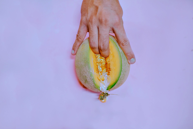 fingers inside cantaloupe, sexually suggestive