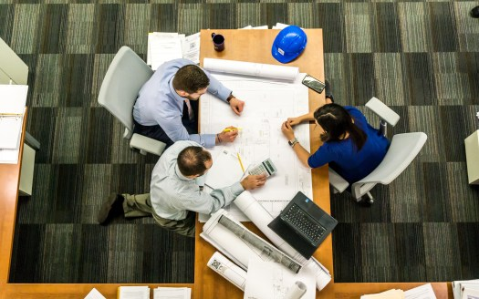 Three People working on Project Management Task