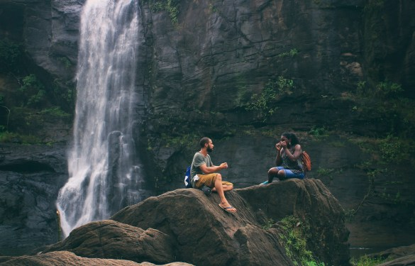 Man and Woman Near Waterfall talking