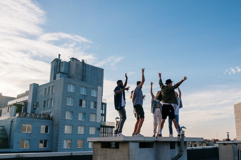 3 Men Jumping on Top of Building