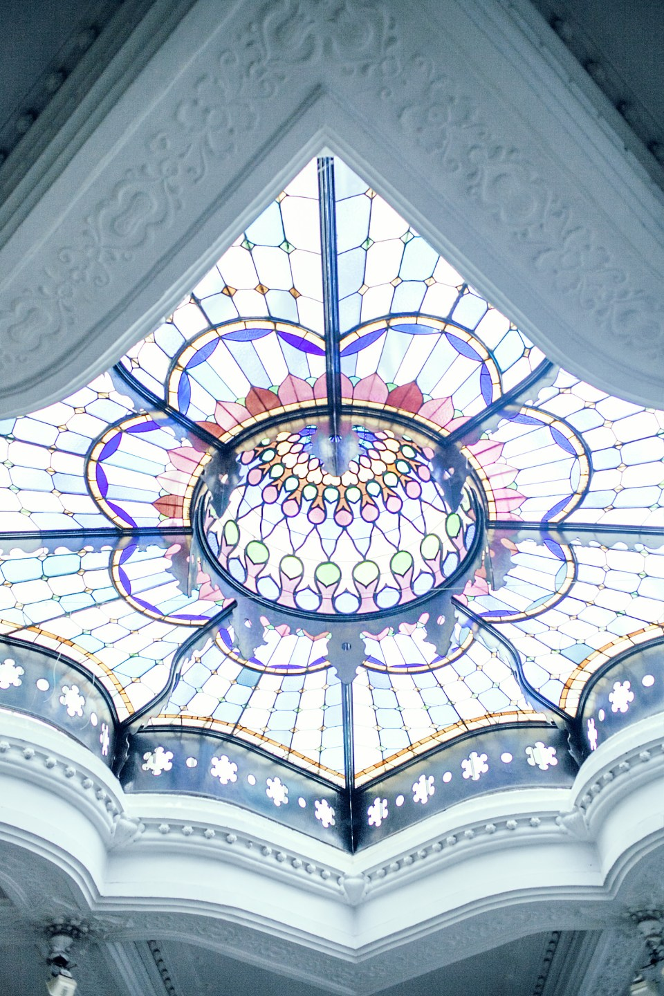 Old classic ceiling with stained glass