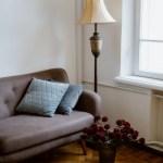White And Black Throw Pillow On Brown Sofa Free Stock Photo