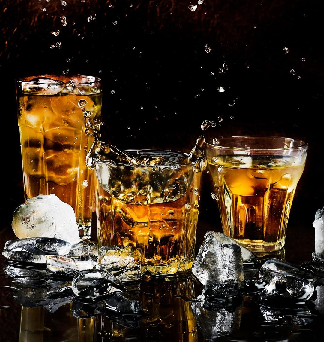 three full glasses of whiskey