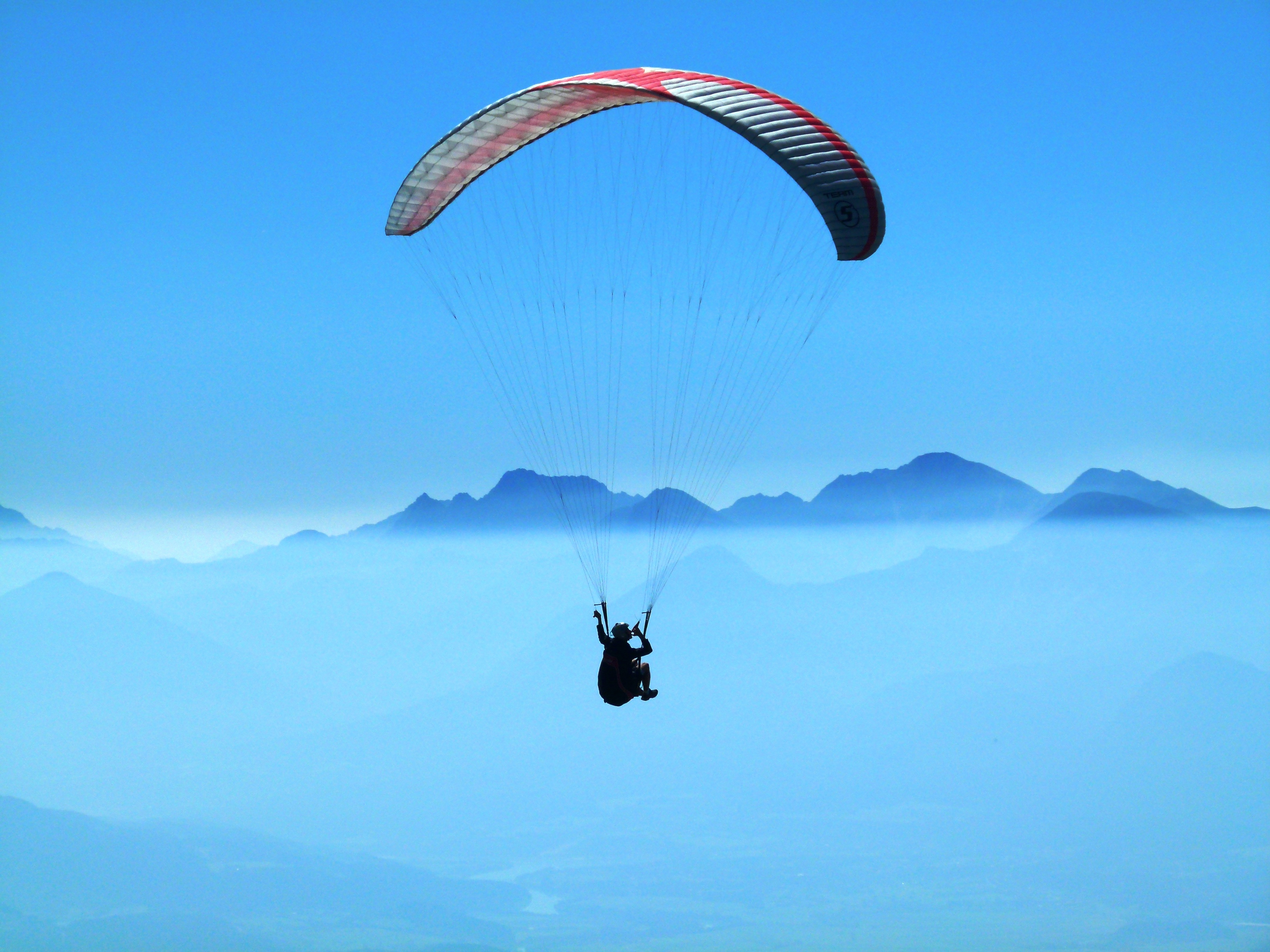 Person Using Red Parachute On Mid Air Free Stock Photo