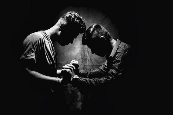 Grayscale Photo of Two Men Holding Hands my biggest fear in life how to over come fear  what is fear