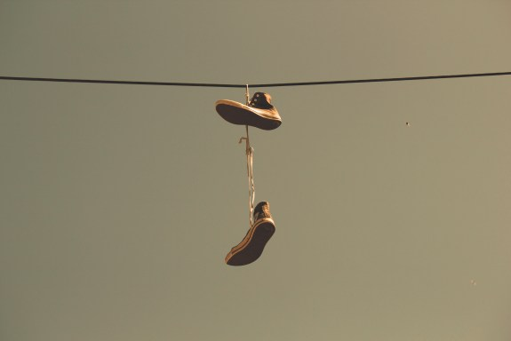 White Black High Top Shoes Hanging on Electric Line