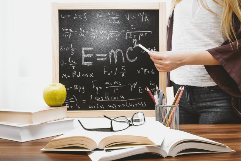 Woman Illustrating Albert Einstein Formula