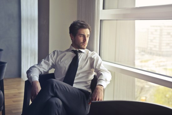 Man Wearing White Dress Shirt and Black Necktie
