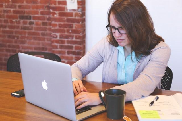 Woman Looking at Macbook