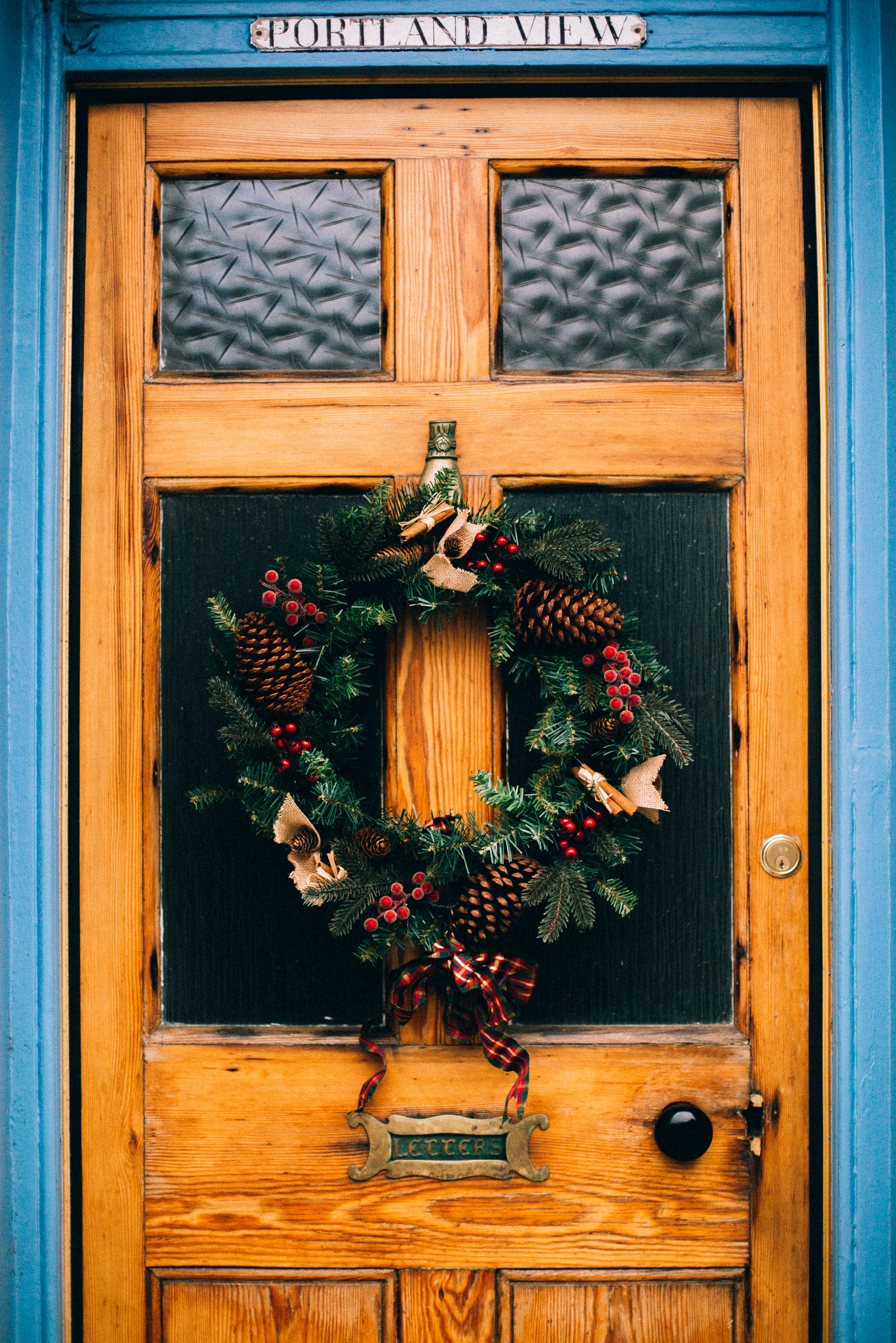 Green And Red Christmas Wreath On Door 183 Free Stock Photo