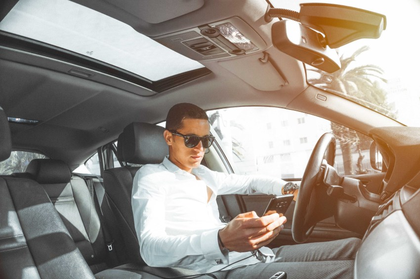 Man in White Dress Shirt Holding Smartphone