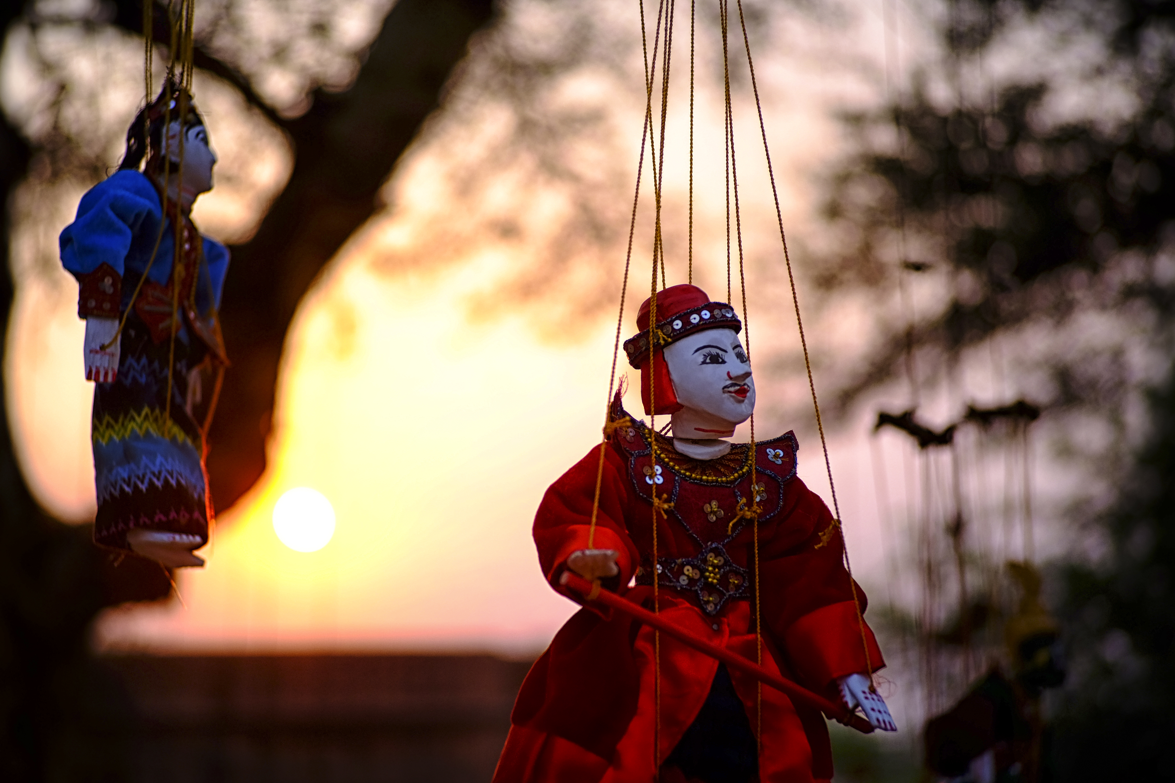 Puppets manipulated with strings
