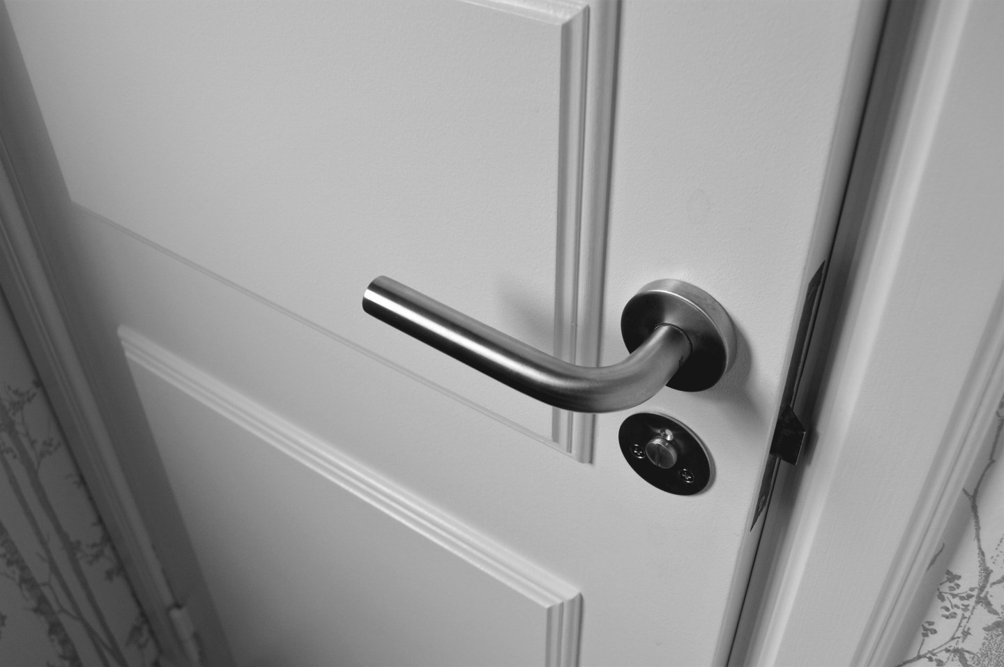 photograph of a door handle on a white door