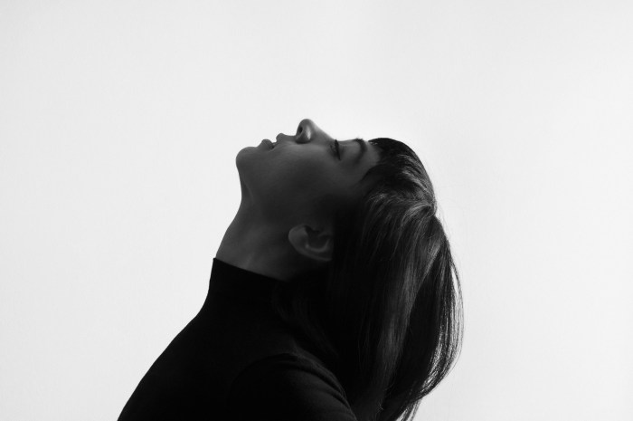 Female Grayscale Photo Facing Upward