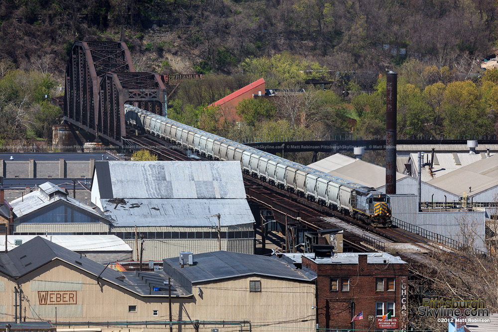 Allegheny Valley Railroad pulls a line of covered hoppers in Pittsburgh
