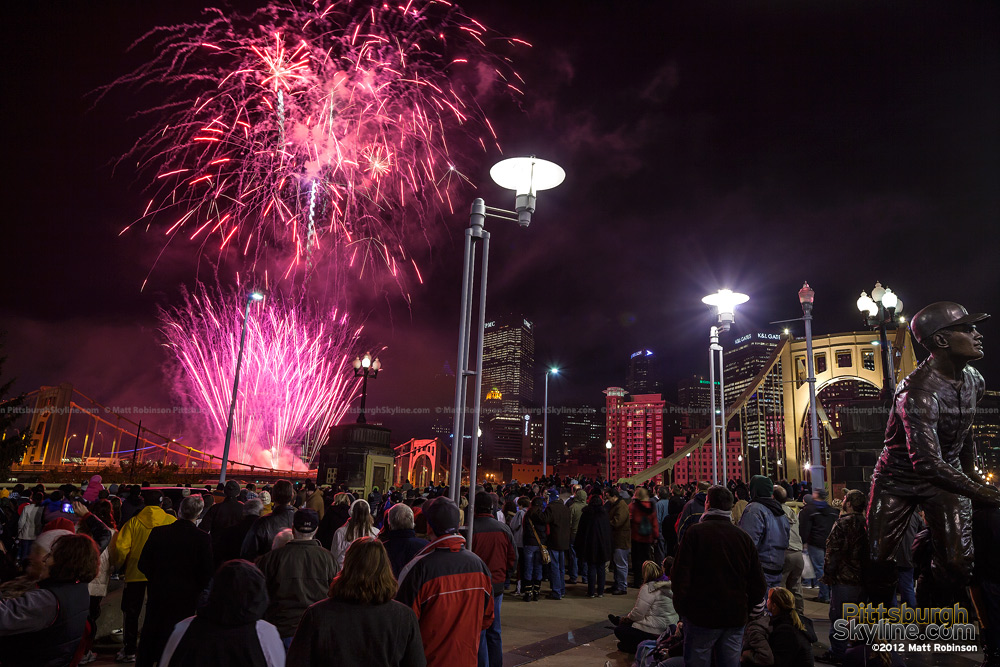 Crowds watch fireworks from the Roberto Clemente Bridge near PNC Park
