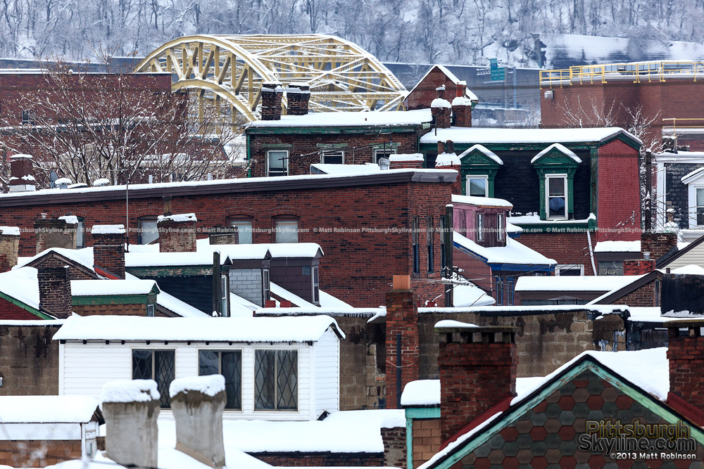 Snowy rooftops with 16th Street Bridge