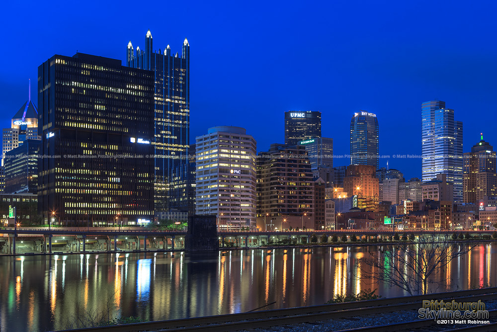 Pittsburgh skyline at dusk from Three Rivers Heritage Trail along the Mon River