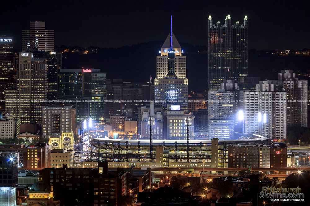 Light standards illuminate PNC Park with the Highmark Building and PPG Place
