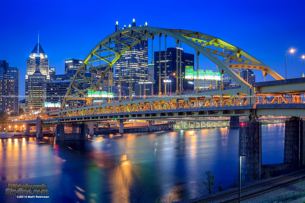 The Fort Pitt Bridge leads into downtown Pittsburgh at night