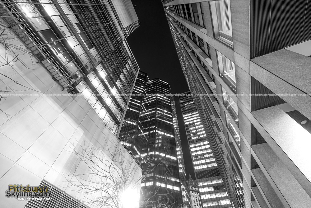 Looking up at Pittsburgh buildings in black and white