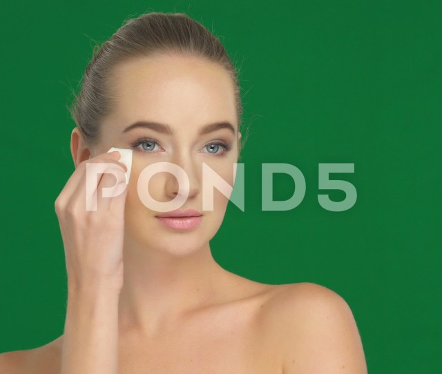 Beautiful Girl Applies Cosmetics On The Face With A Makeup Sponge Footage 81092978