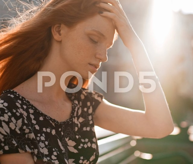 Video Beautiful Redhead Teen Girl Thoughtfully Adjusts Hair And Looking Away With Pen 71497644