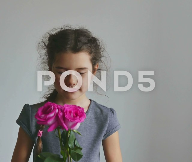 Video Girl Teen Smelling A Rose Flowers On A White Background