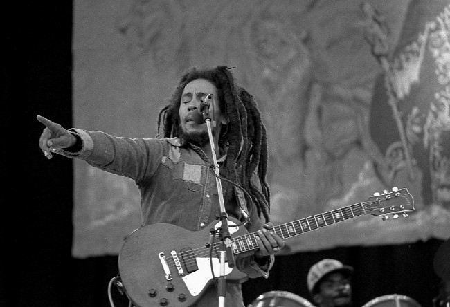 Bob Marely on stage with a guitar