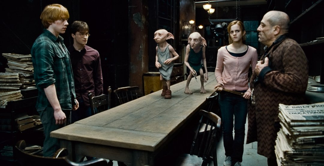 Dobby and Kreacher deilver Mundungus to Ron, Hermione and Harry in Grimmauld Place.