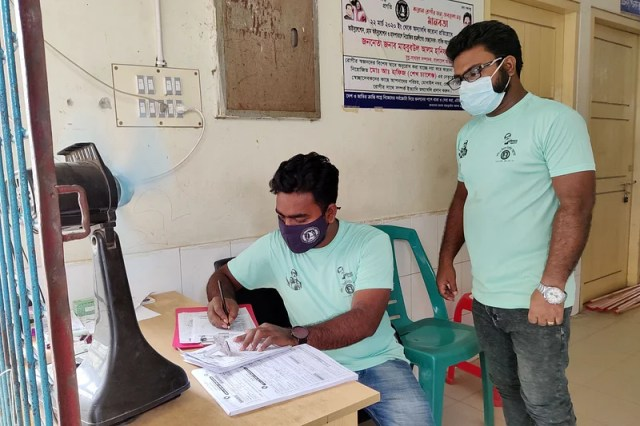 Two volunteers are working at the entrance of Corona Ward of Kushtia General Hospital.  June 3 morning