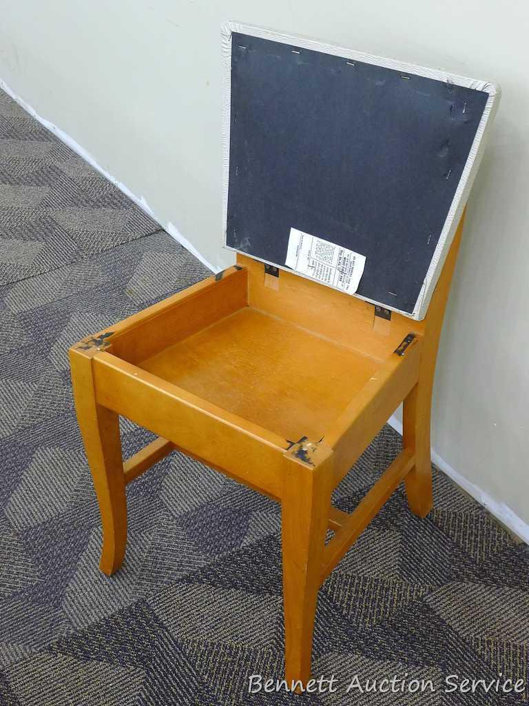 vintage sewing chair has lift up seat