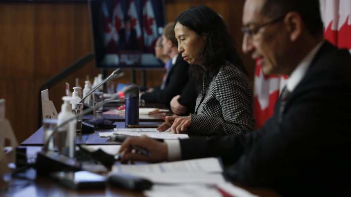 Dr. Theresa Tam, Chief Public Health Officer of Canada, looks at her notes at a press conference in Ottawa.