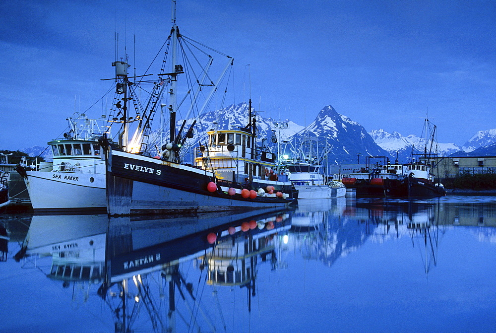 Ships in Valdez harbour with snowy mountains