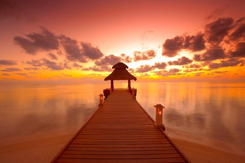 Jetty at sunset, island on North Male Atoll, Maldives, Indian Ocean