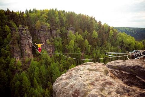 Stock Adventure Photo: Tightrope walker: Highline in the sandstone