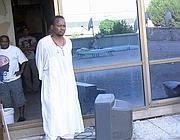 Uno dei rifugiati dell' «Hotel Africa» (foto Ansa)