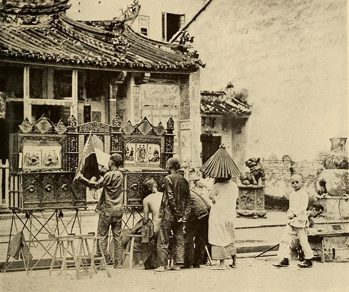 A Chinese puppet show exhibited in front of a Chinese Temple in Kuching, Sarawak in 1919.