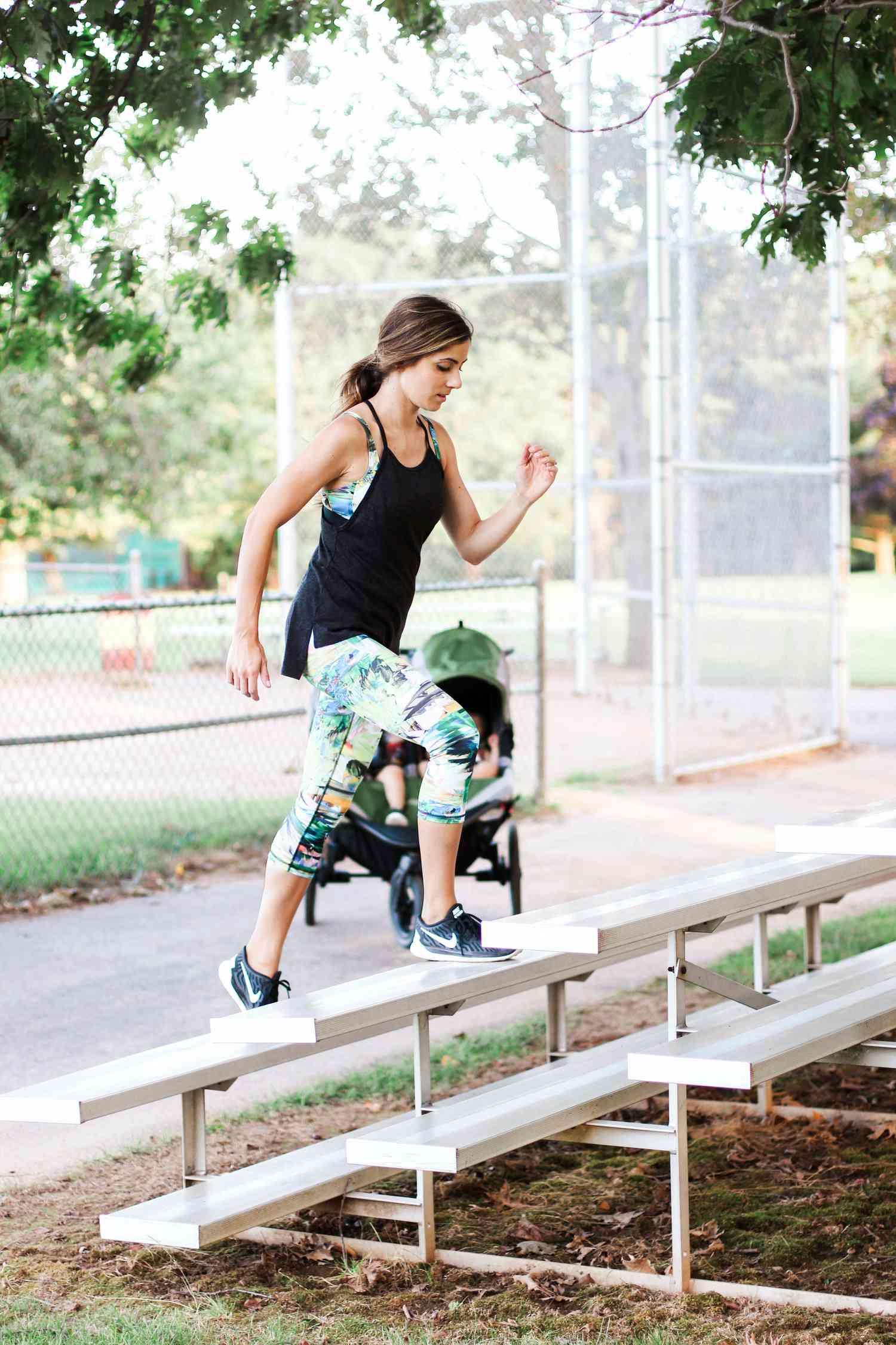 woman exercising on bleechers